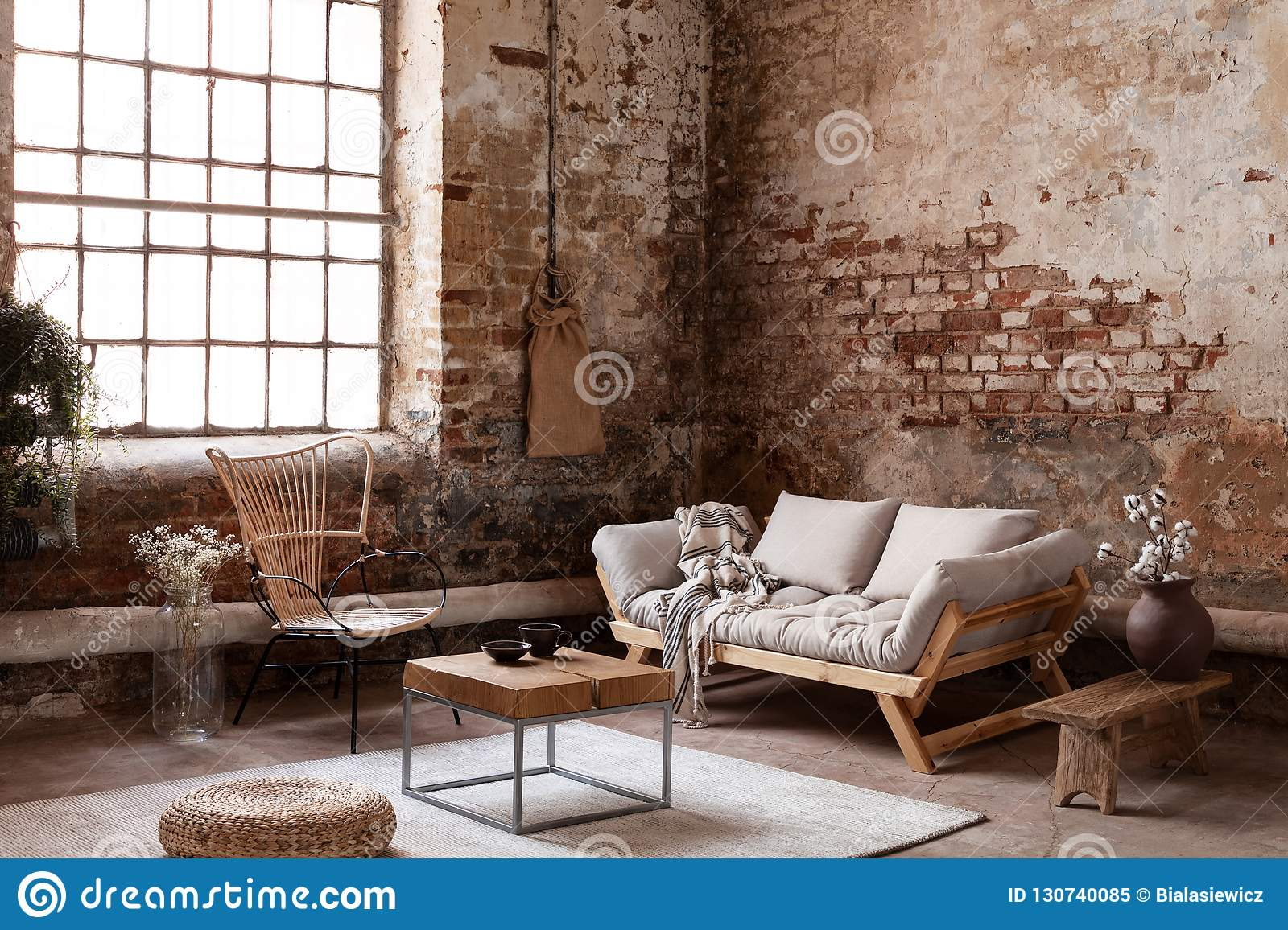 Armchair And Beige Sofa In Industrial Living Room Interior ...