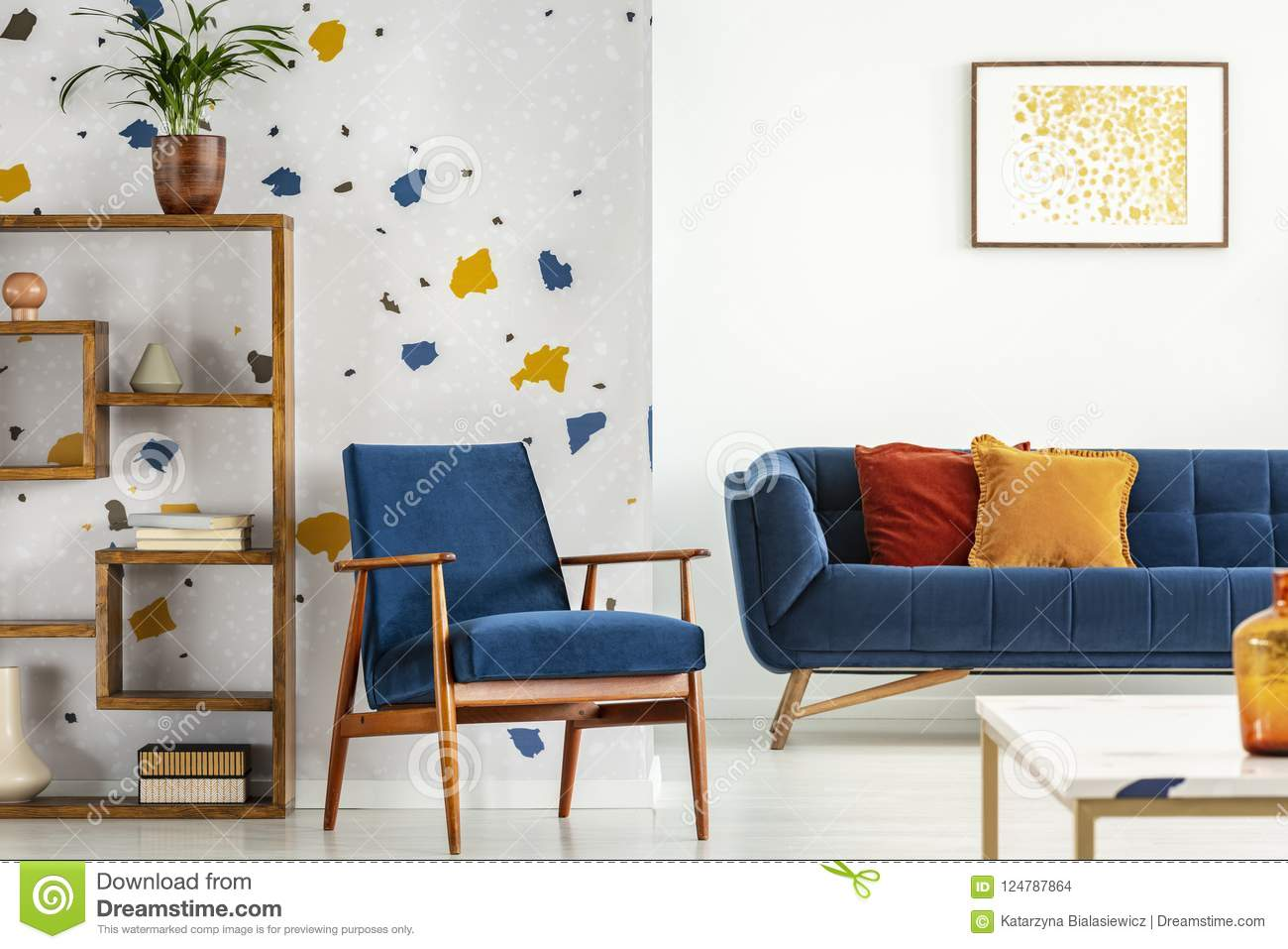 Armchair And Couch With Pillows In Blue And Orange Living Room Interior With Poster And Plant Real Photo Stock Photo Image Of Home Living 124787864