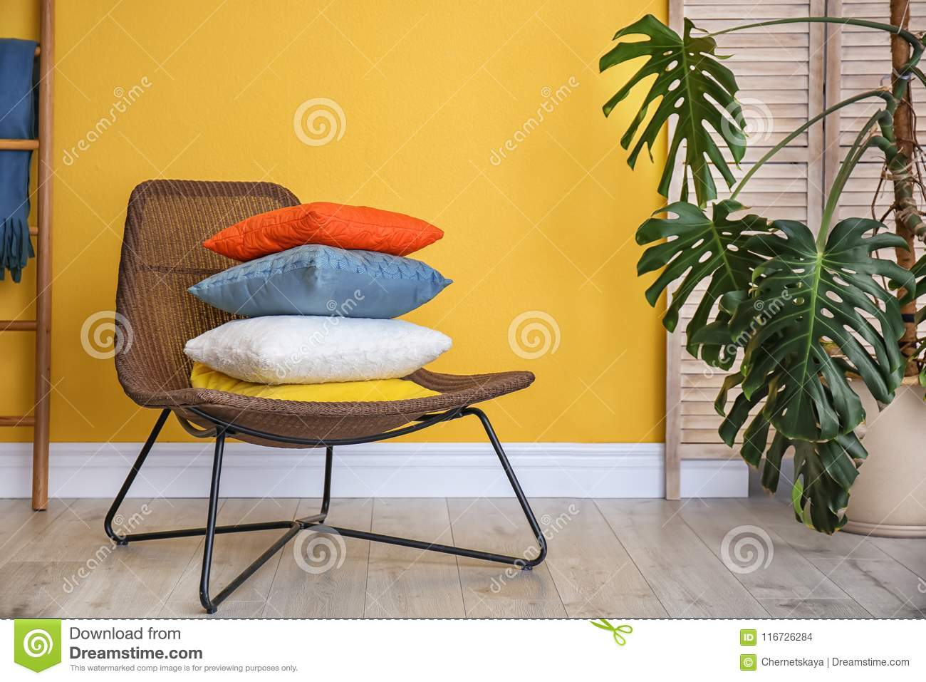 Armchair With Different Pillows Near Color Wall Stock Photo - Image ...