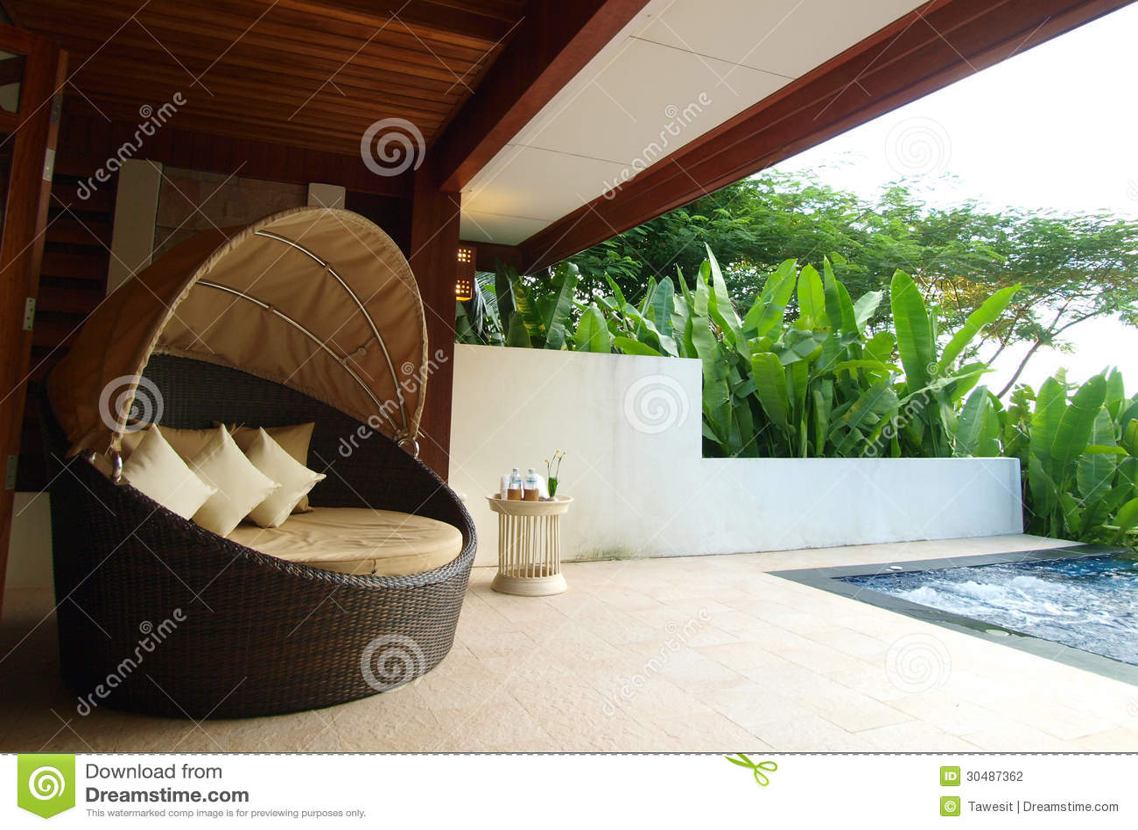 Armchair on luxury resort terrace