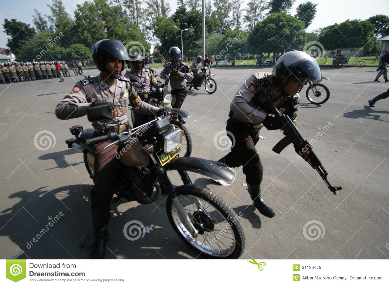 Armed police jump from motorcycle to face the protester in riots
