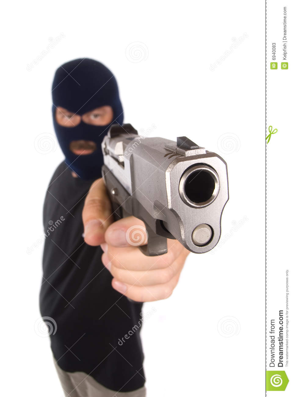 robber with hidden face points his gun in a robbery attempt.