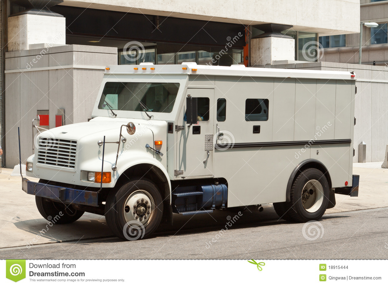 http://thumbs.dreamstime.com/z/armoured-armored-car-parked-street-building-18915444.jpg