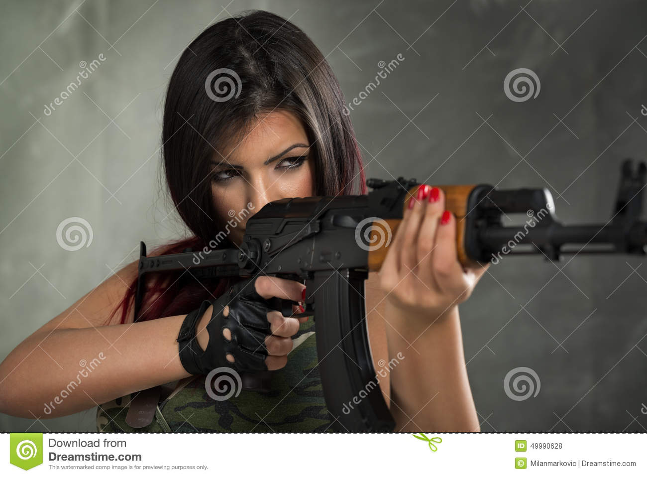 The military naked army girl holding a gun here against
