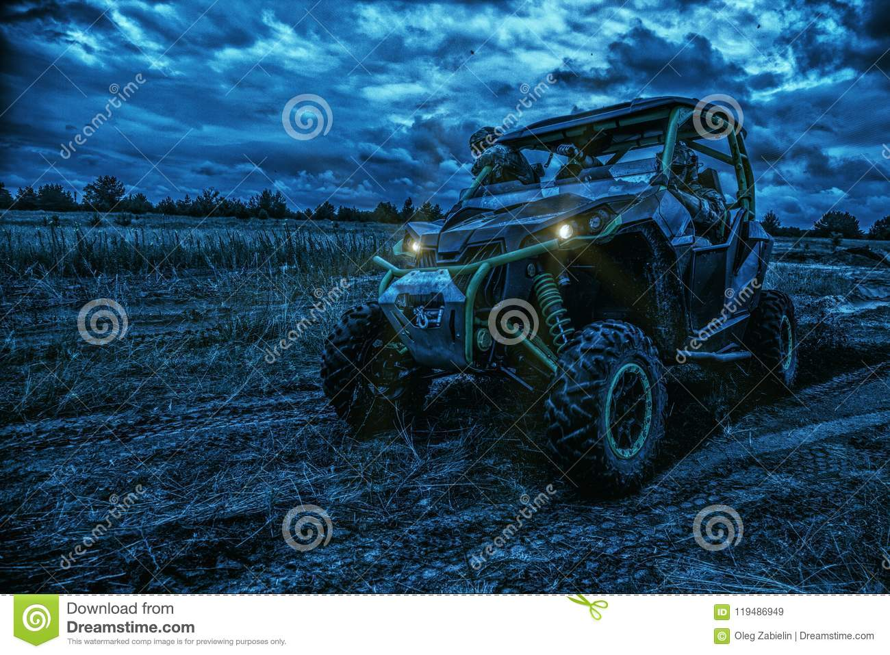 Army rangers moving on military buggy at night