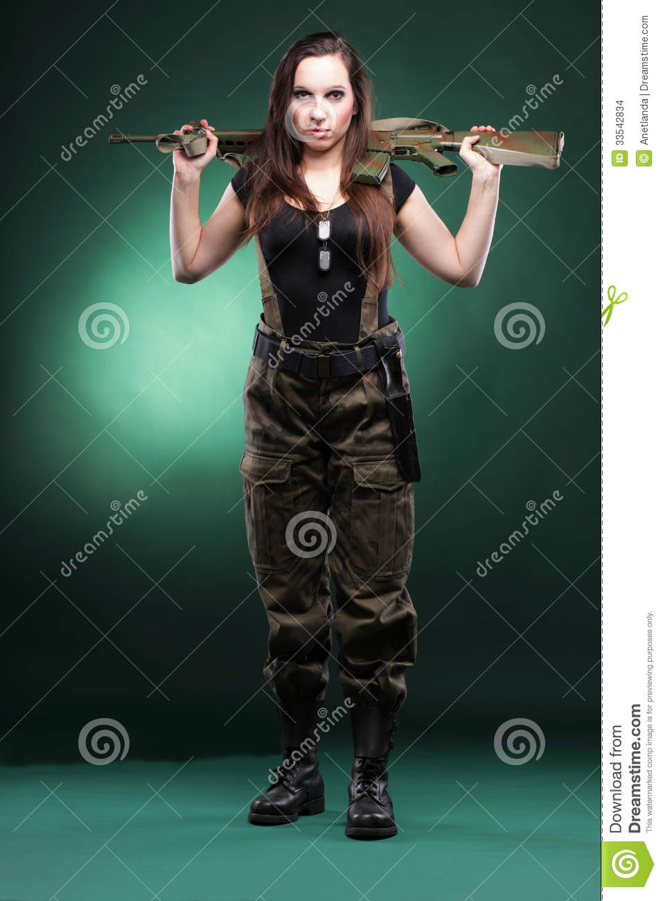 Military naked army girl holding a gun thought