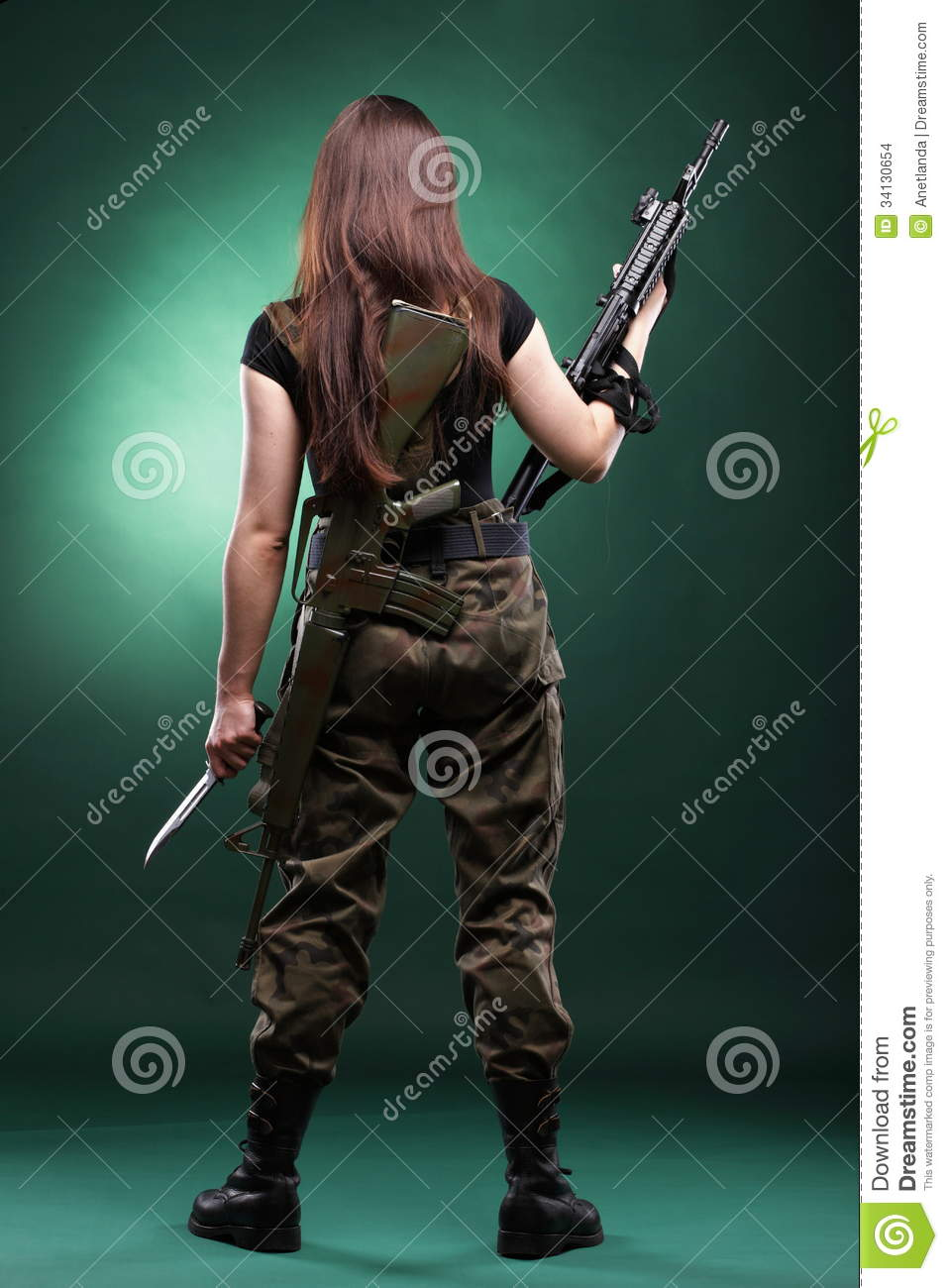 Military naked army girl holding a gun