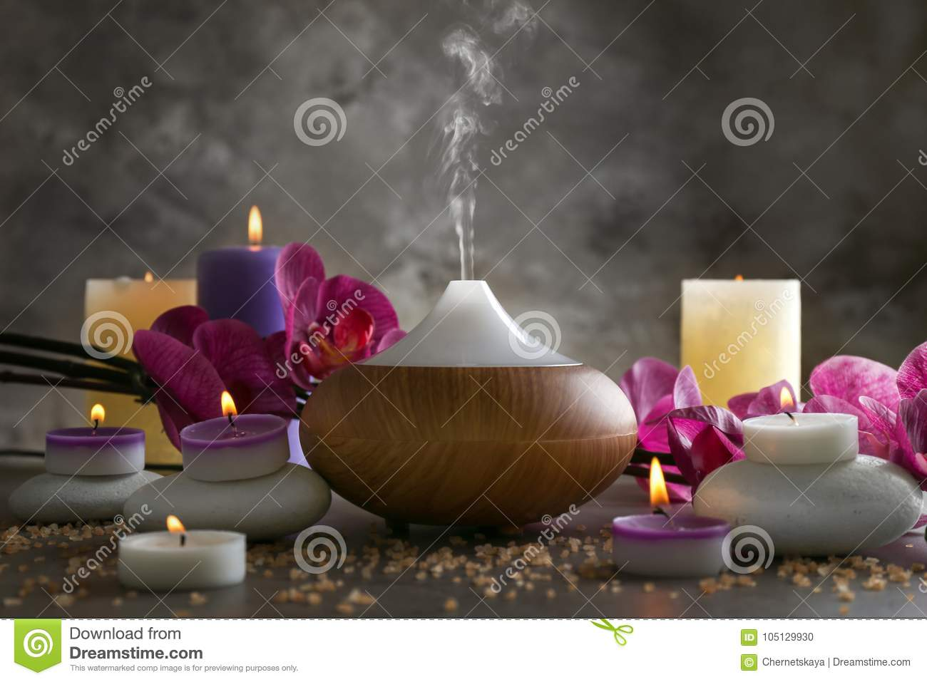 Aroma oil diffuser, candles and flowers