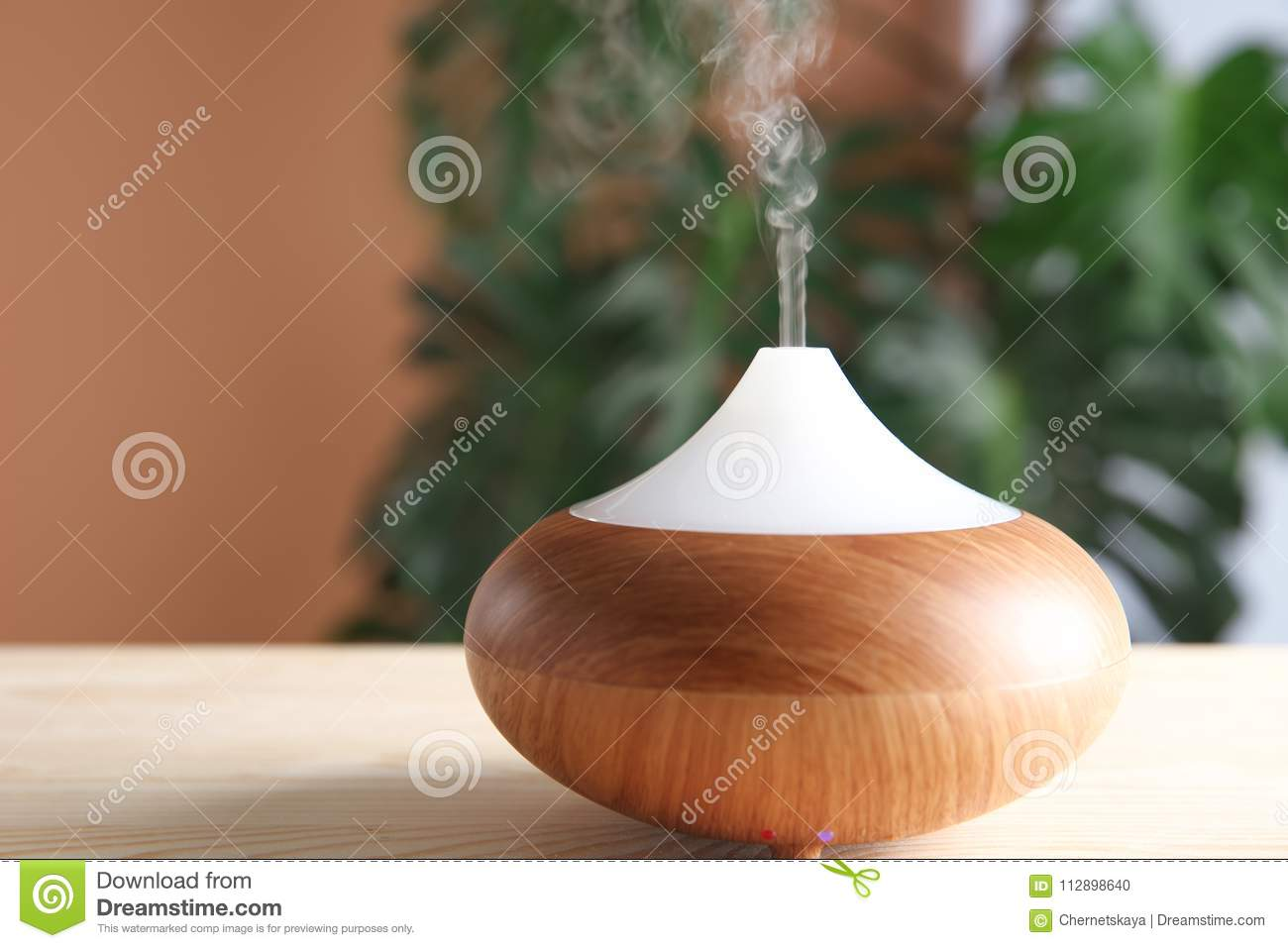 Aroma oil diffuser on table