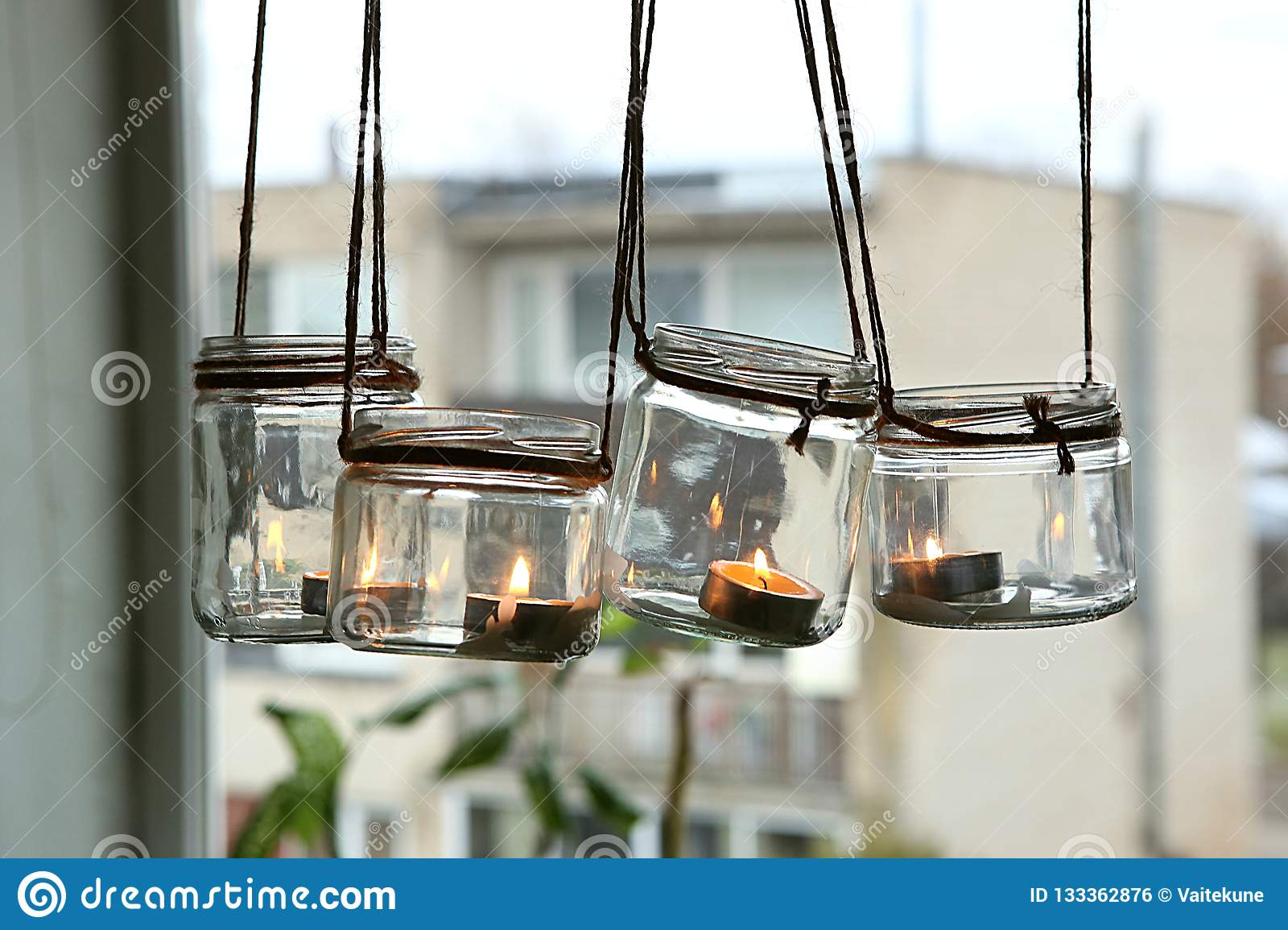 Aromatic Candles In Glass Jars Hanging In Kitchen Stock Photo