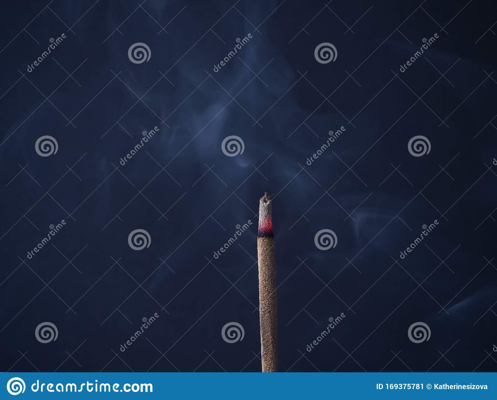 Aromatic Incense Stick Is Burning With Beautiful Gray Curls Of Smoke On A Dark Blue Background In A Meditation Room Stock Image Image Of Incenses Dark 169375781