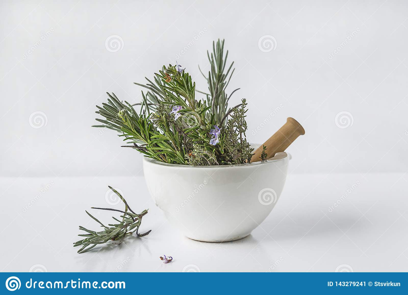 Aromatic plant: lavender, rosemary, thyme in the white ceramic mortar with pestle on white background