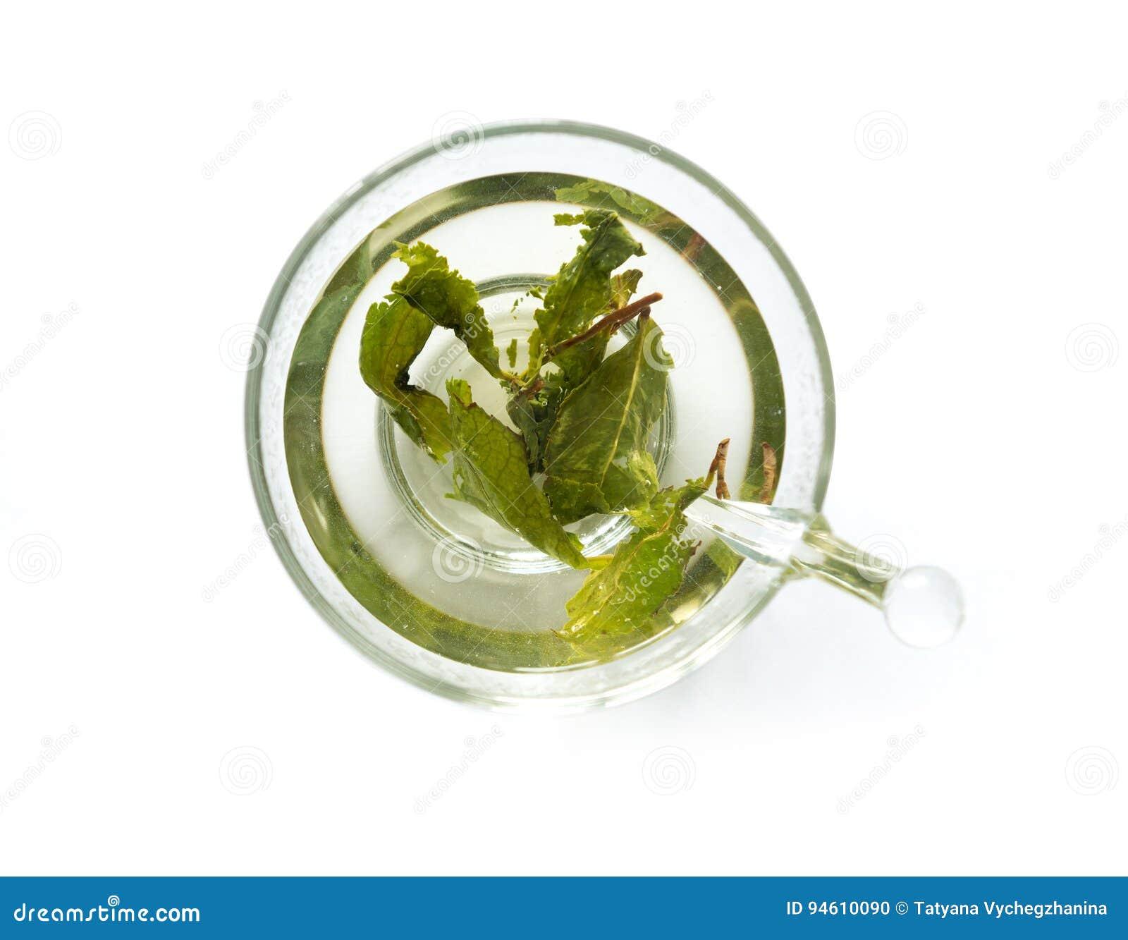 Aromatyczna zielona herbata warząca w filiżance, topview