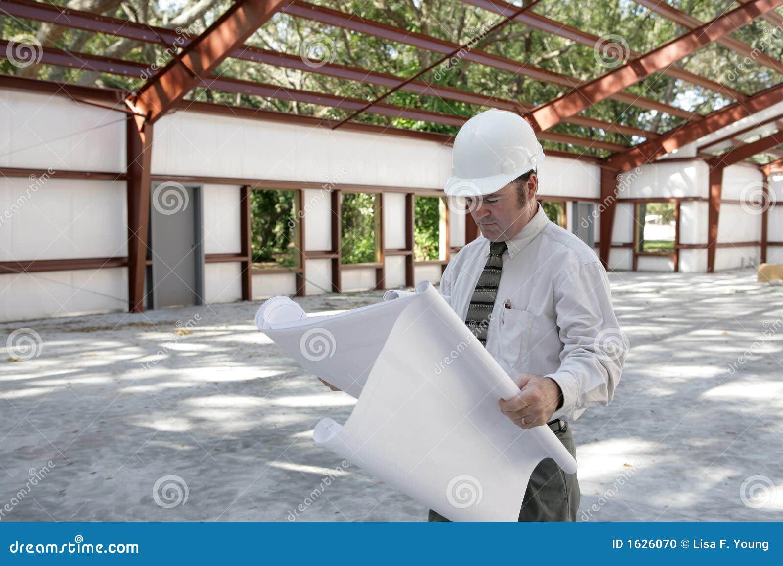 Arquitecto en lugar de trabajo foto de archivo imagen for Mesa de trabajo para arquitectos