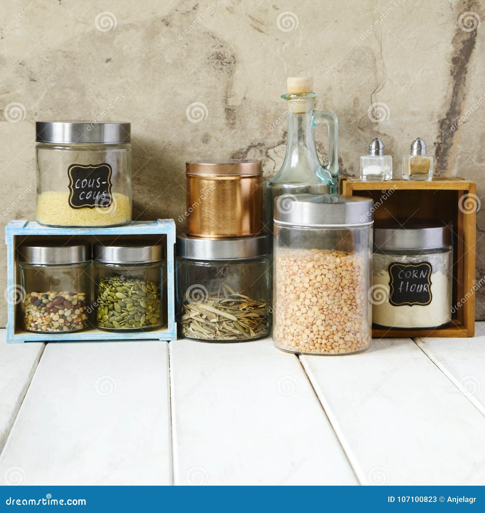 Kitchen Shelf Arrangement: Arrangement Of Dry Food Products And Kitchen Utensils In