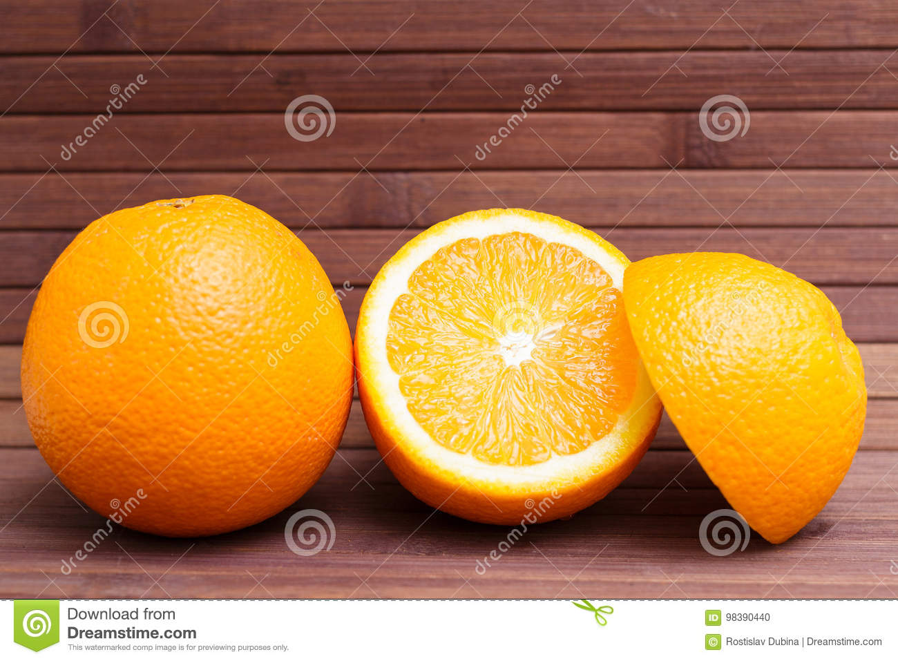 Arrangement of orange isolated on wooden background. Healthy food. A mix of fresh fruit. Group of citrus fruits. Vegetarian, raw.