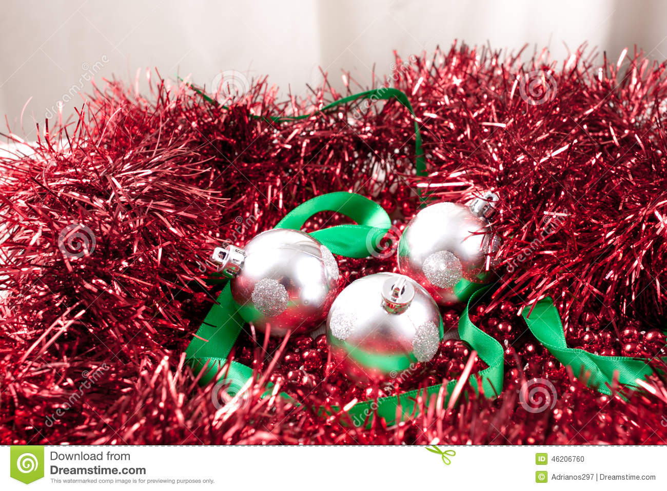 Arrangement Of Silver Christmas Ornaments And Ribbon On Garland
