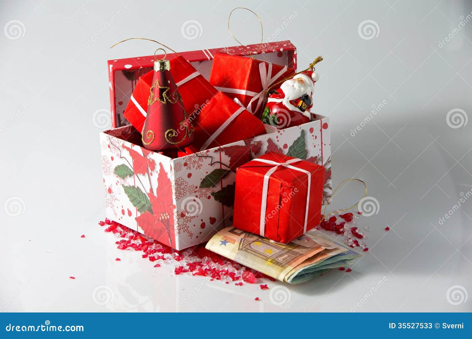 arreglos y dinero de la navidad fotos de archivo
