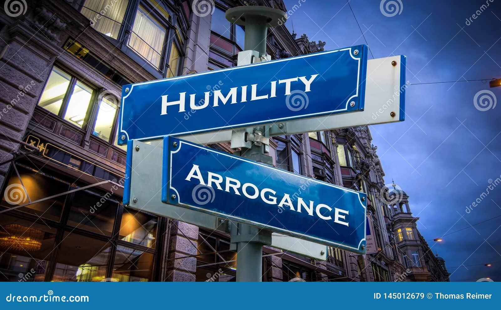Arrogans för ödmjukhet för gatatecken kontra