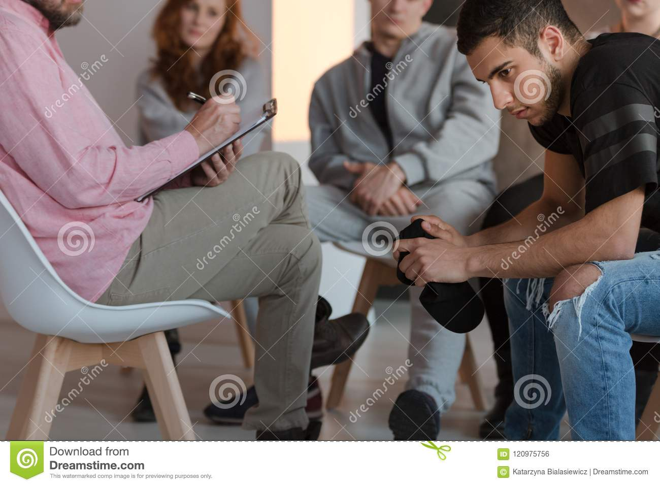 Arrogant teenager sitting at a meeting of support group while hi