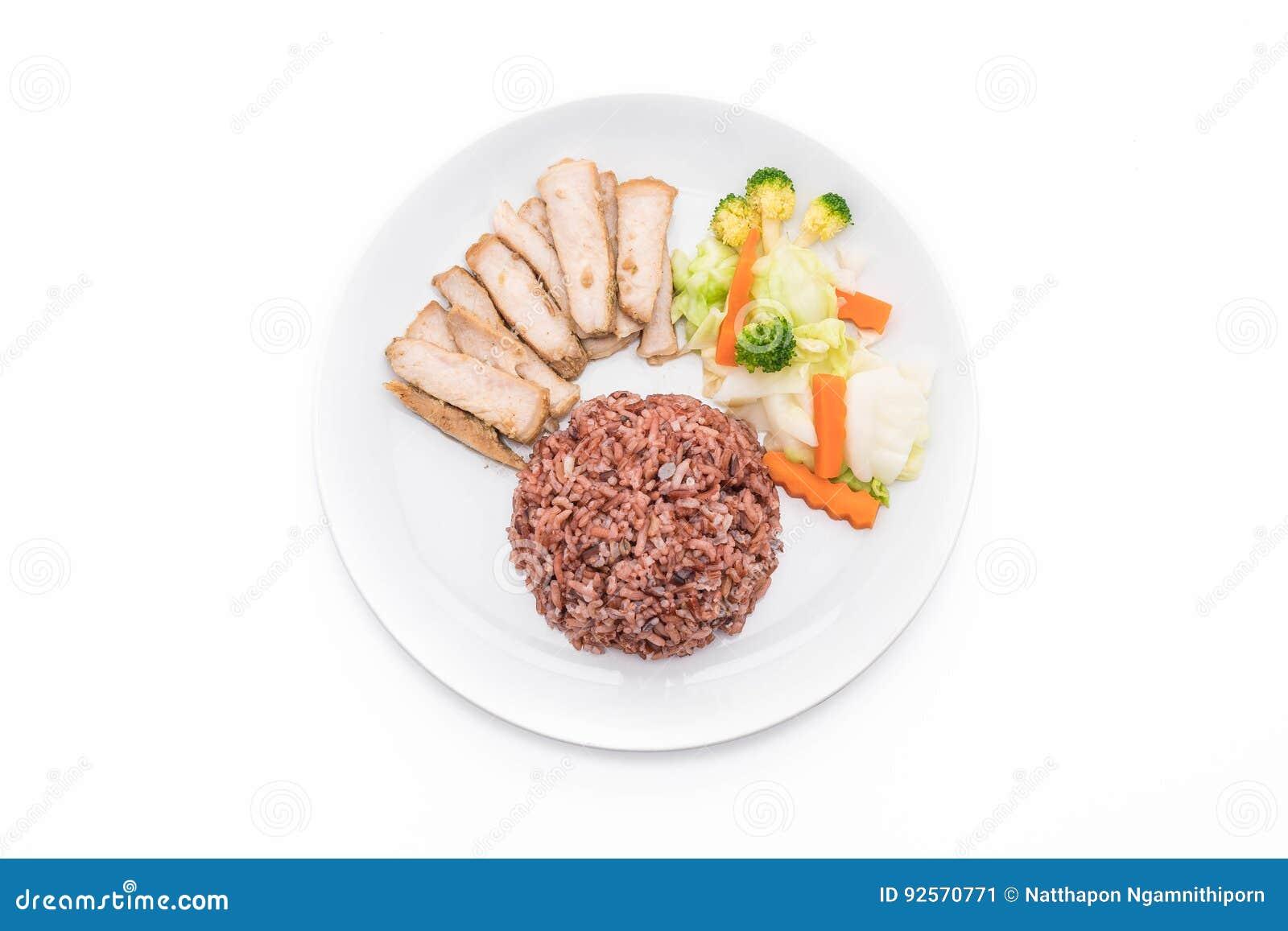 Arrosto di maiale con il riso della bacca