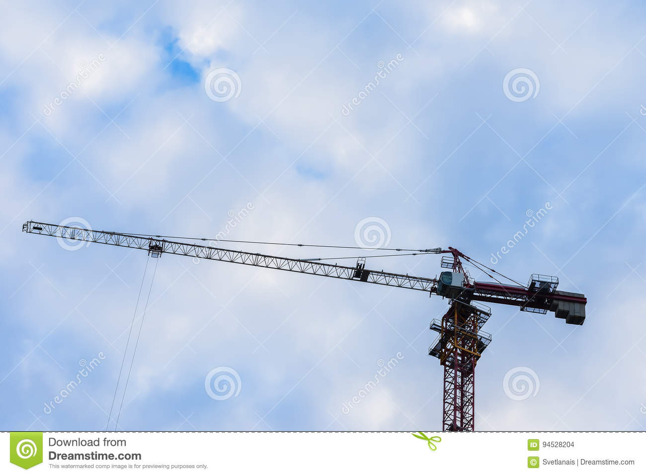Arrow of construction crane for against blue sky with clouds for building of the new very high house. For background use