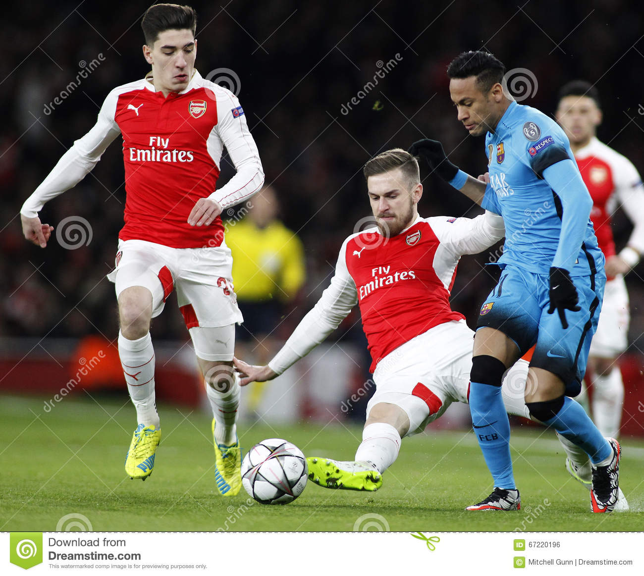 25ae499a039 LONDON, ENGLAND - FEBRUARY 23: Aaron Ramsey of Arsenal and Neymar of  Barcelona compete for the ball during the Champions League match between  Arsenal and ...