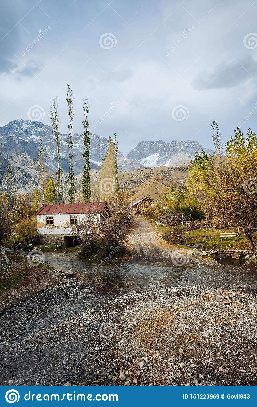 ARSLANBOB, KYRGYZSTAN: View of Arslanbob village in southern Kyrgyzstan, with mountains in the background during autumn.
