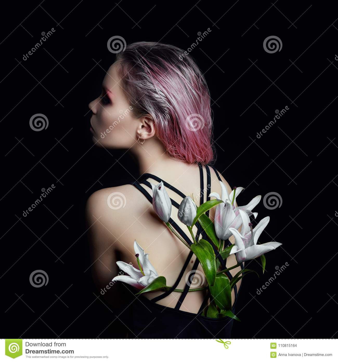 Art beauty girl with lilies behind on a black background. Creati