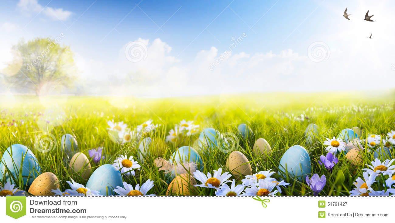 Art Colorful Easter eggs decorated with flowers in the grass