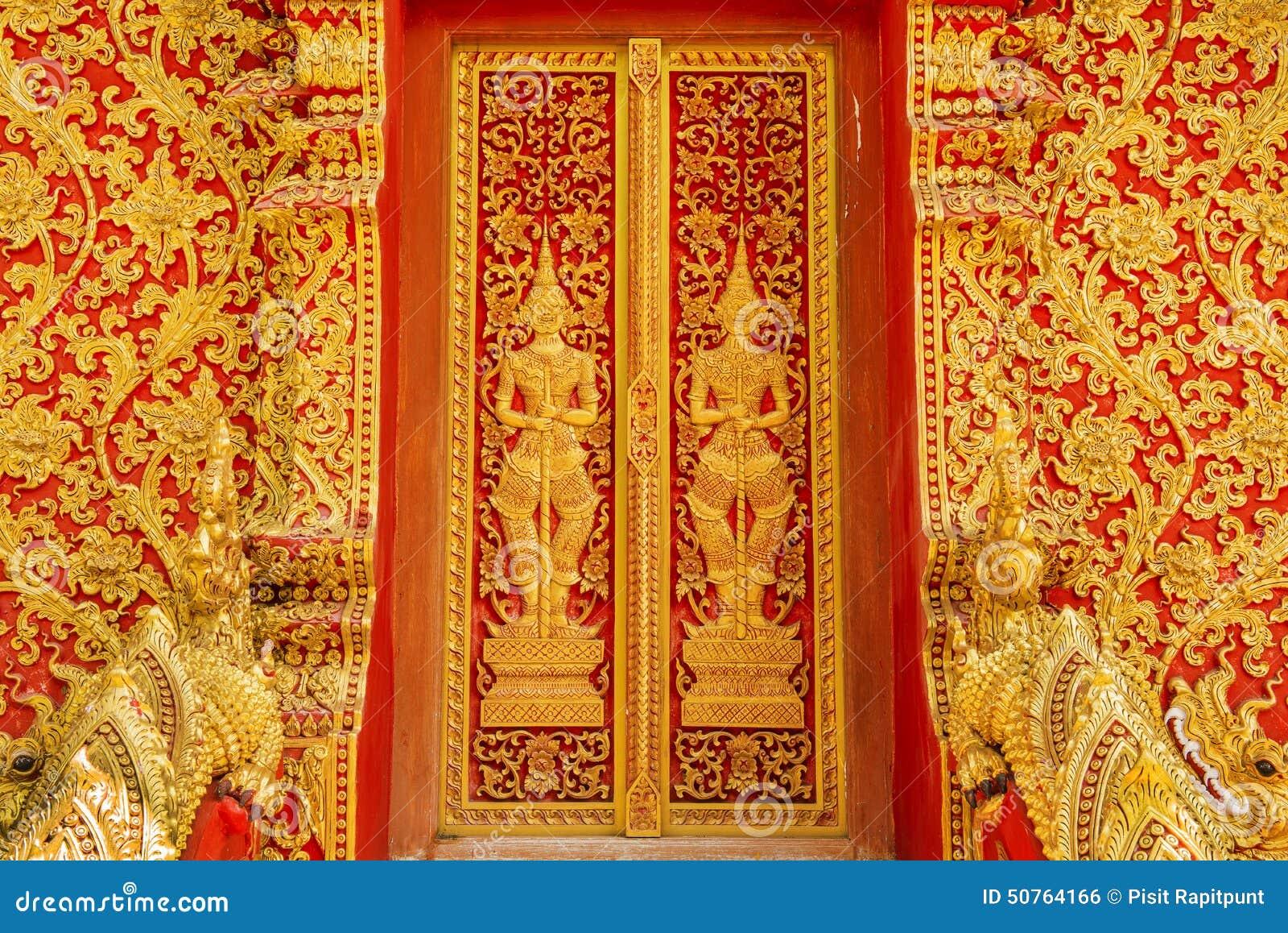 Art door carving guardian giant in the temple thailand