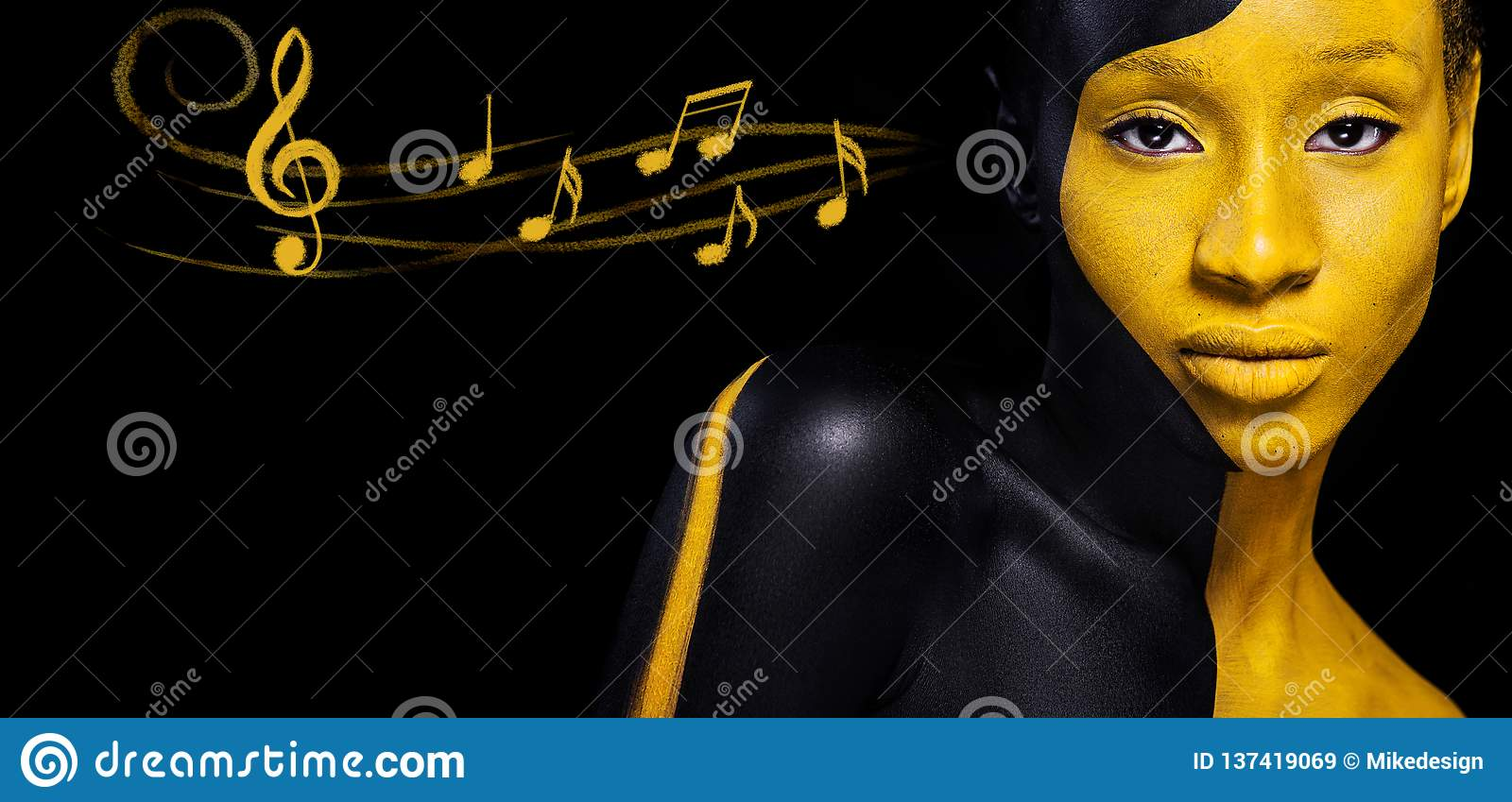 Black and yellow makeup. Cheerful young african woman with art fashion makeup and notes. Colorful paint on body.