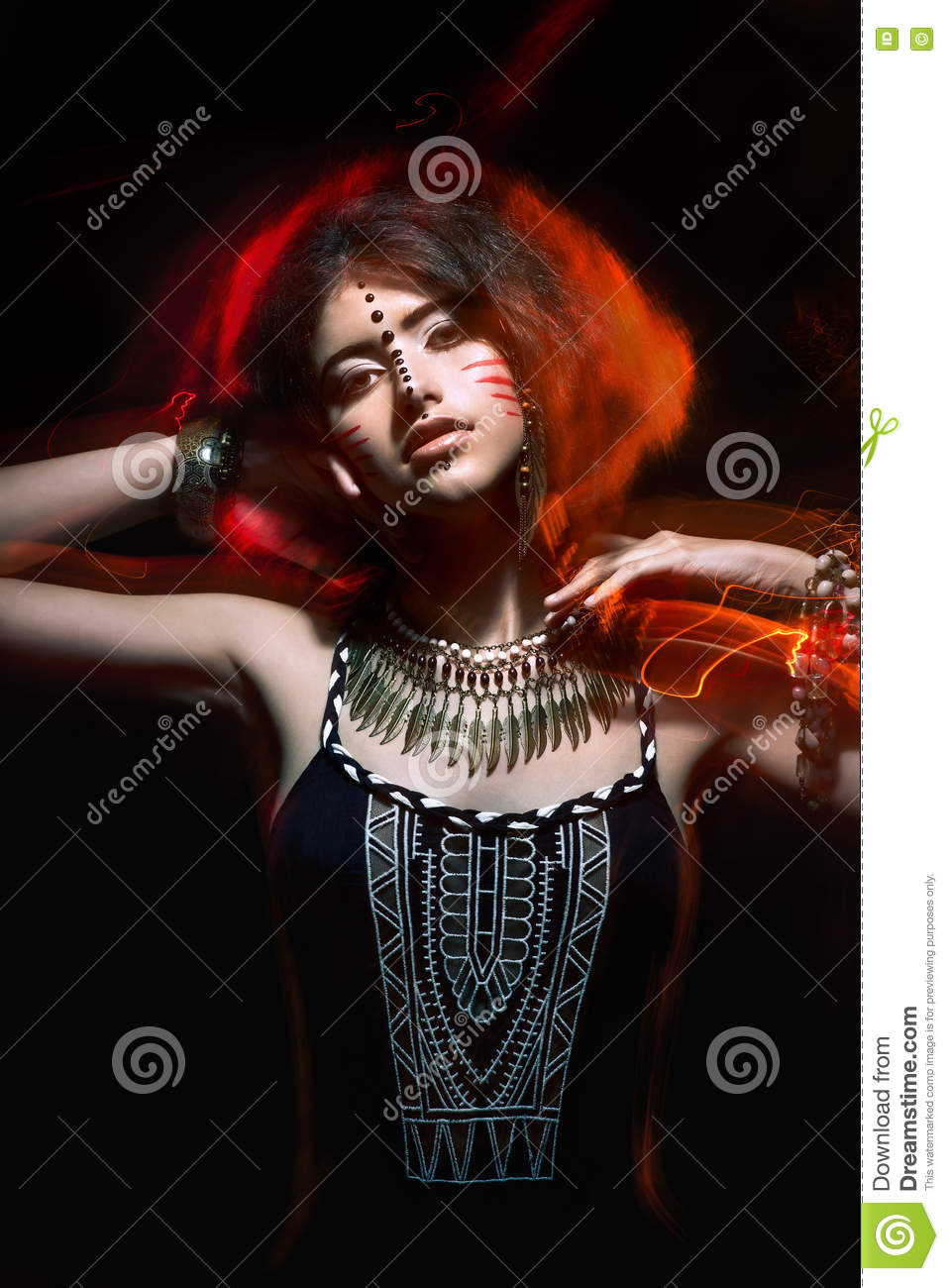 Art fashion portrait of beautiful young woman girl with tribal c