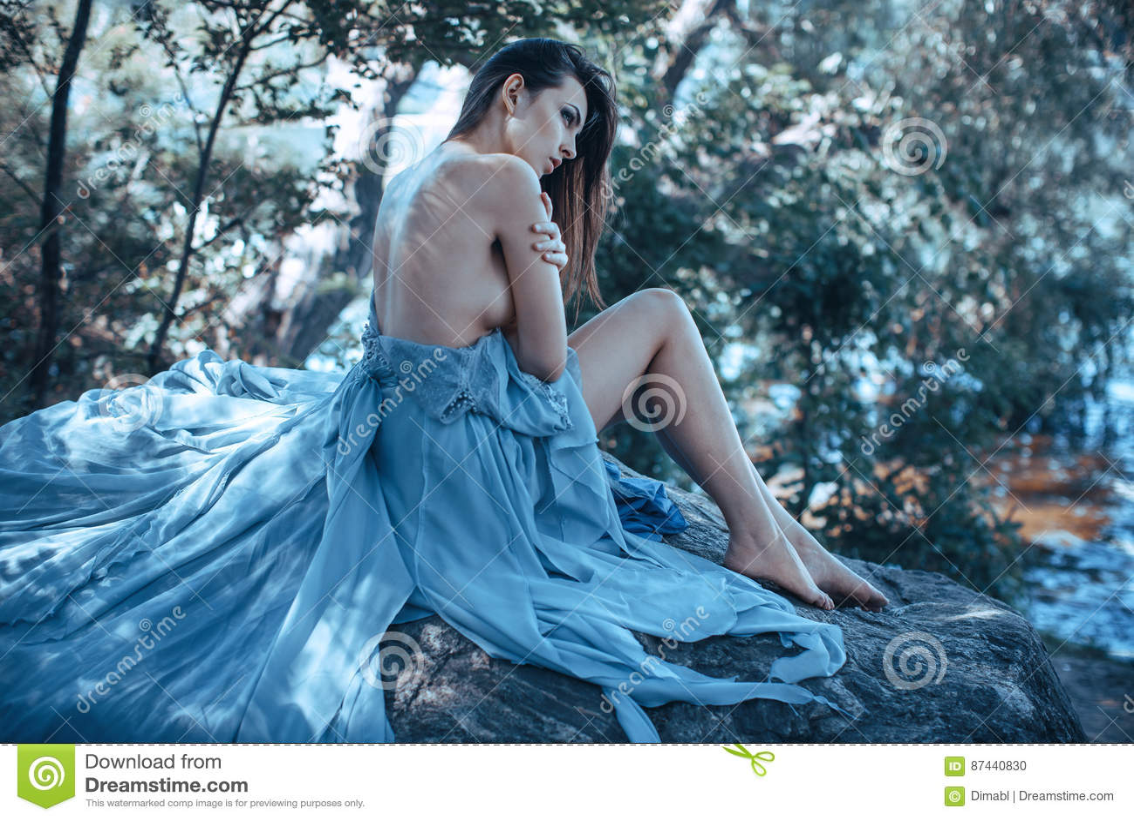 Naked girl sitting on beach all