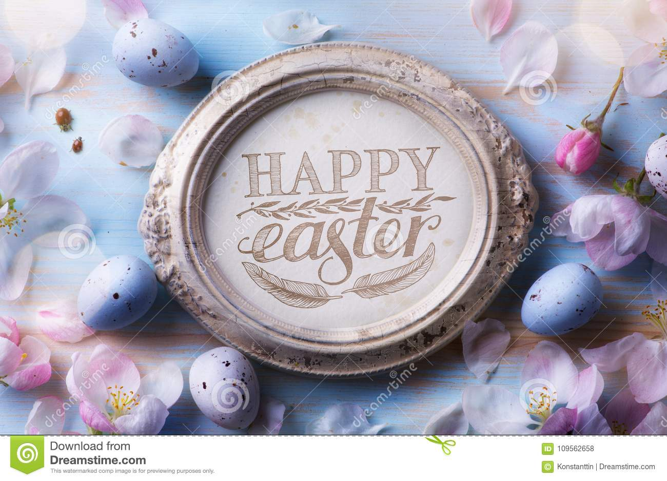 Happy Easter Background; Easter egg and spring flowers on blue t
