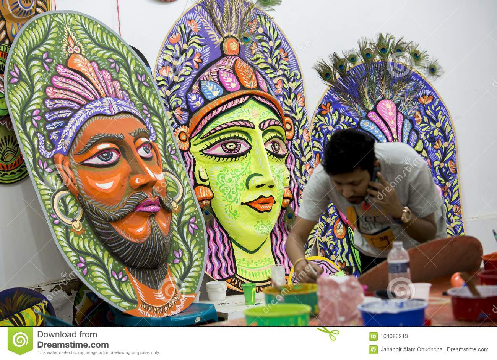 Art institute student preparing a big size colorful mask.