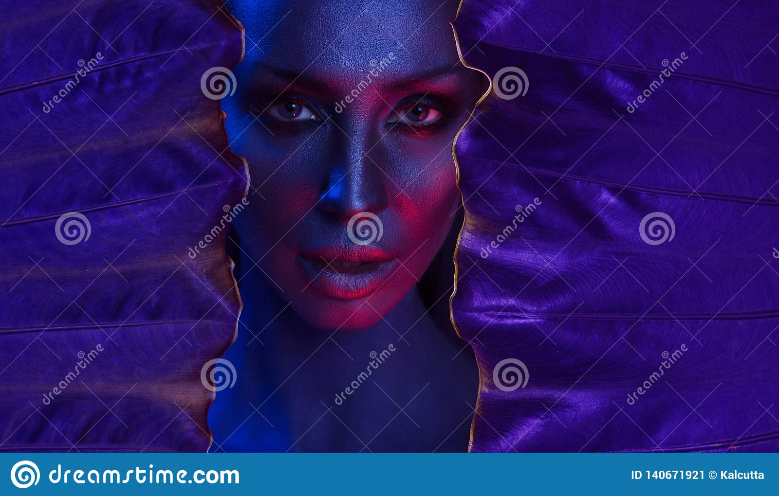 Art neon Portrait of Beautiful Young Woman with glamorous mystical makeup