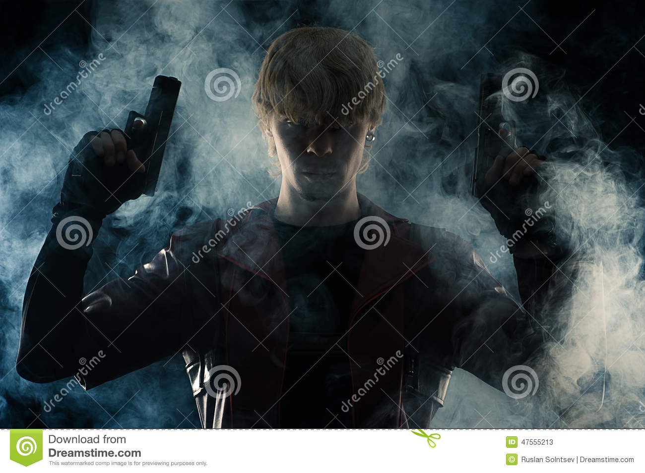Art portrait man with two pistols in hands