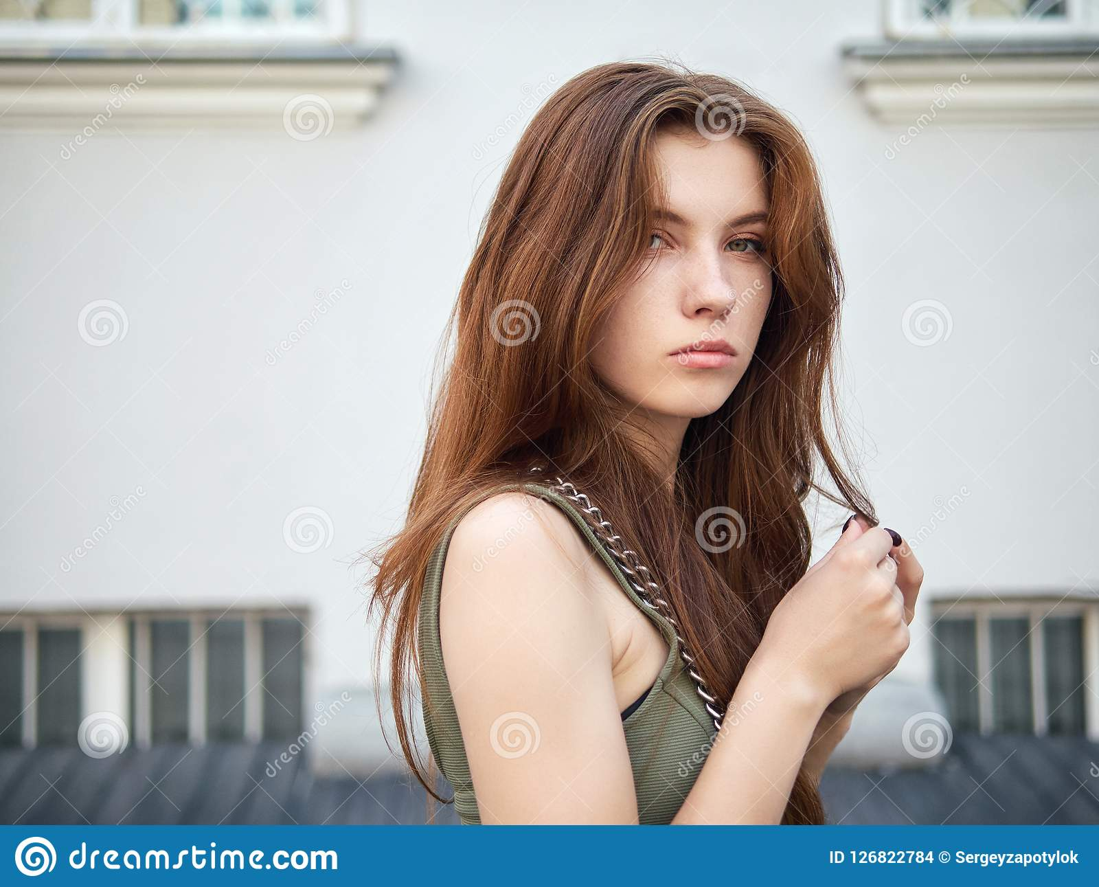 What redhead woman posing the same