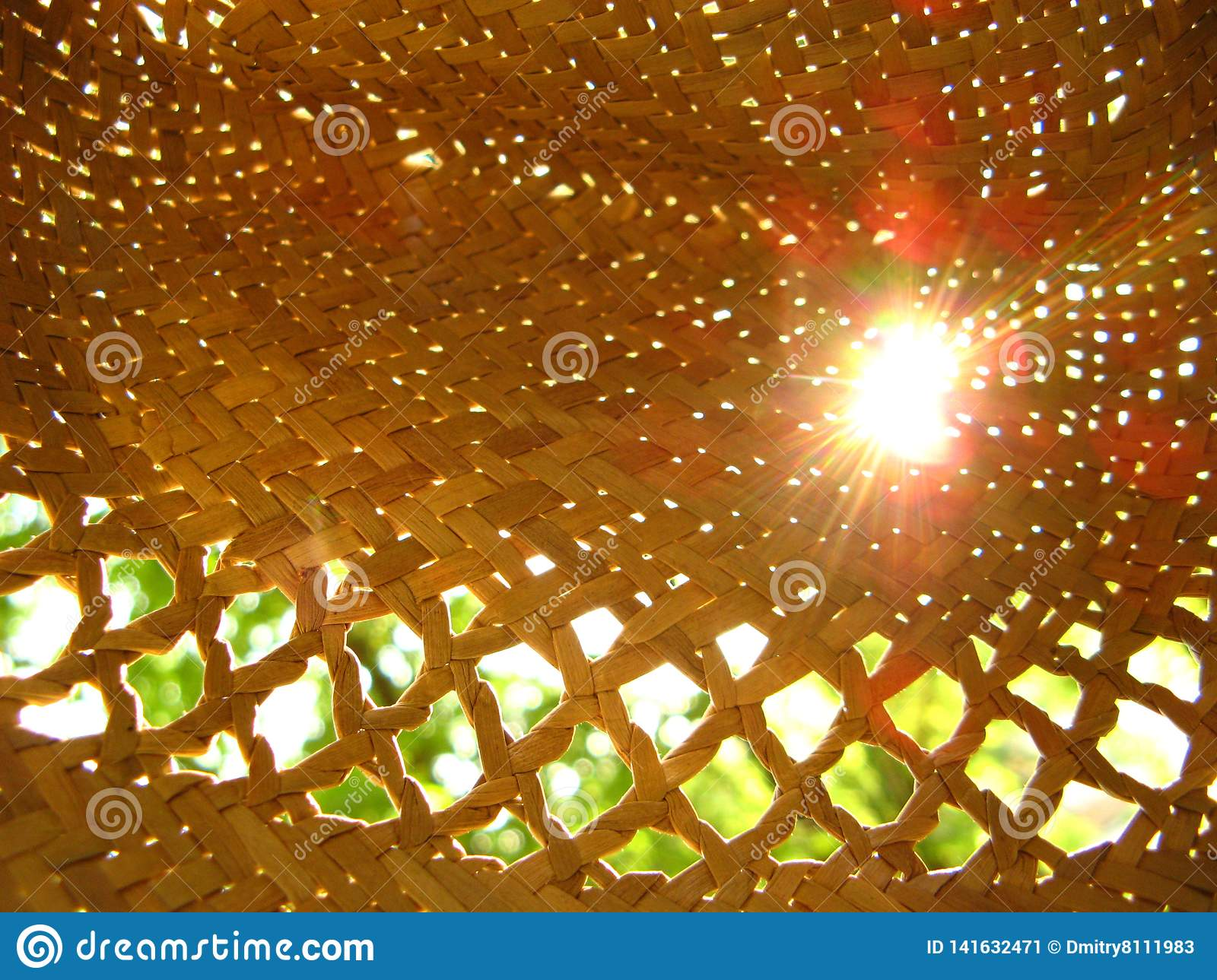 Rays of the sun in a straw hat.