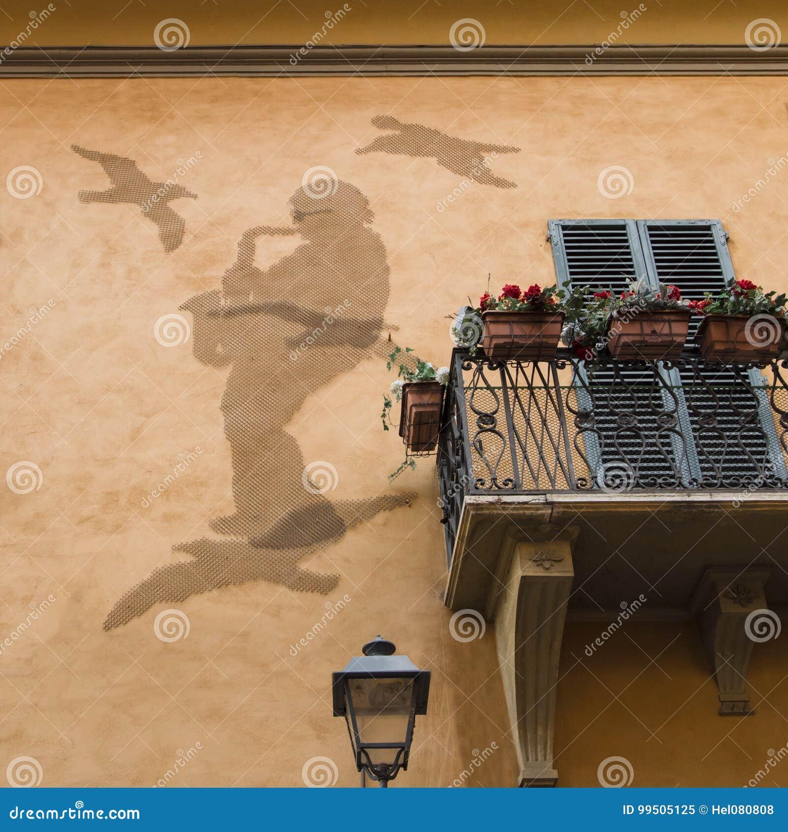 Arte sulla parete della casa: Saxist e piccioni dal cavo di pollo