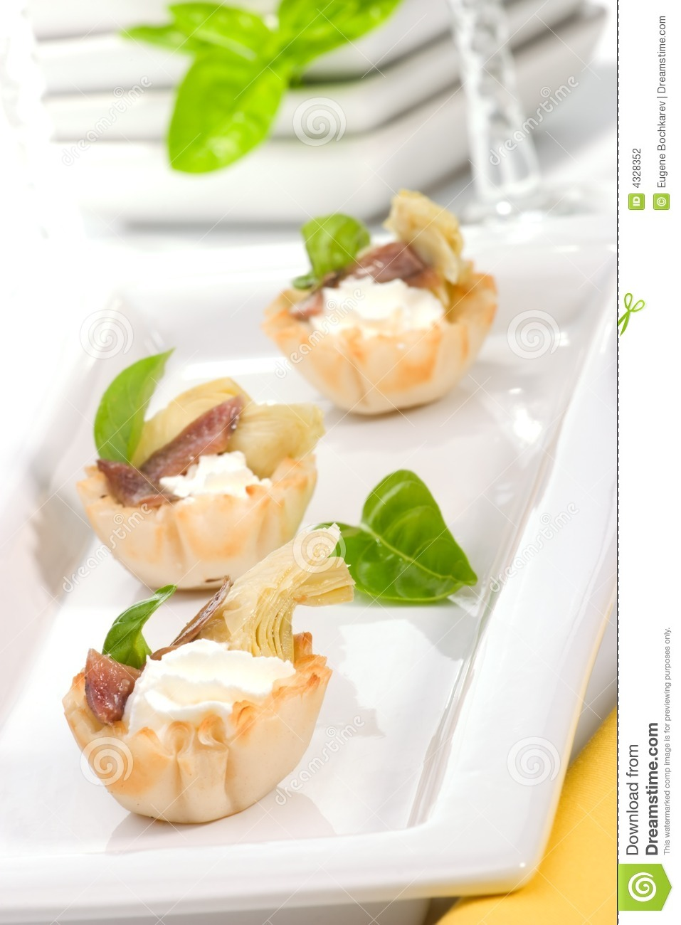 Artichoke anchovy and cream cheese canapes stock photo for Cream cheese canape