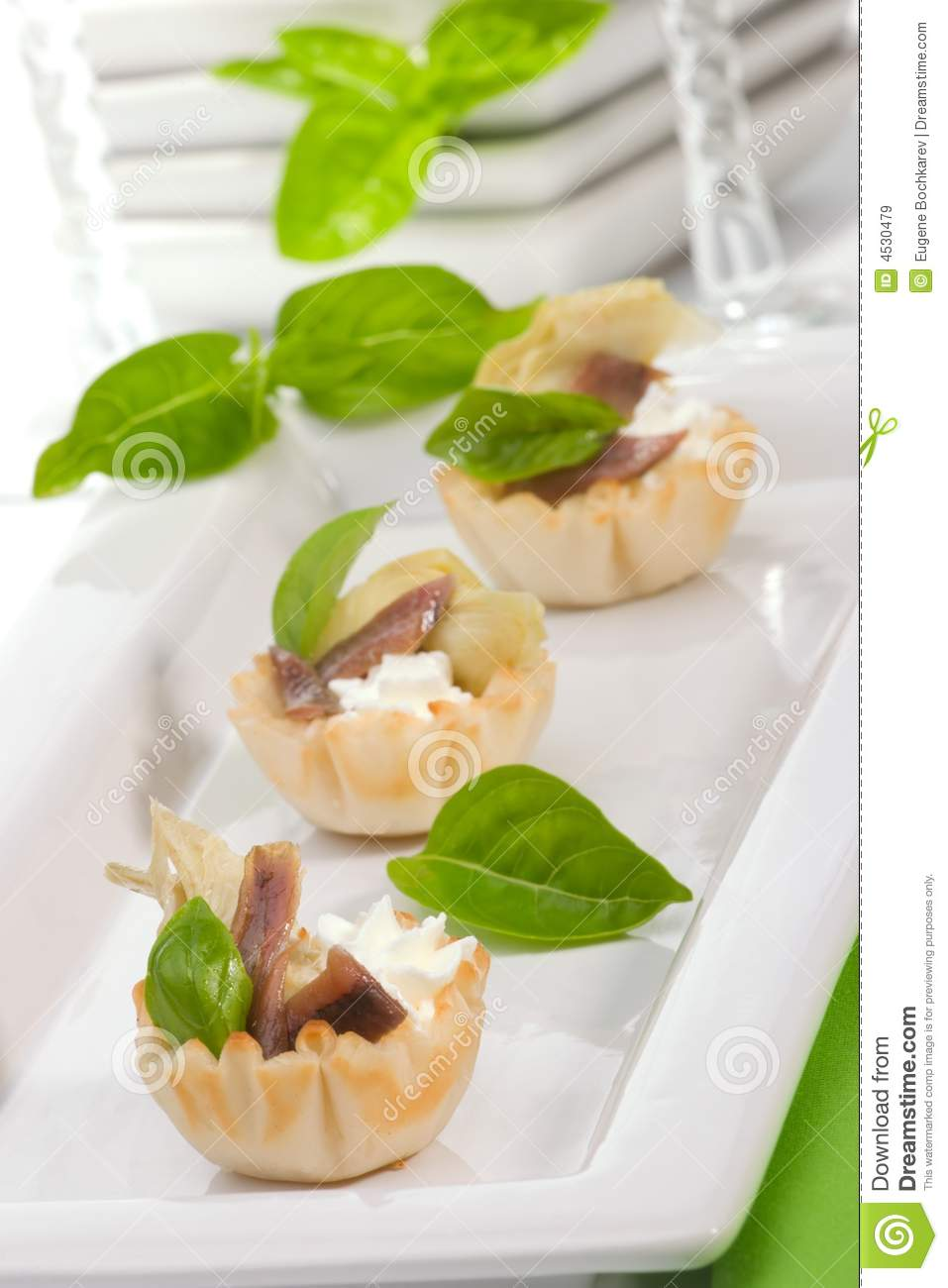 Artichoke anchovy and cream cheese canapes stock image for Cream cheese canape