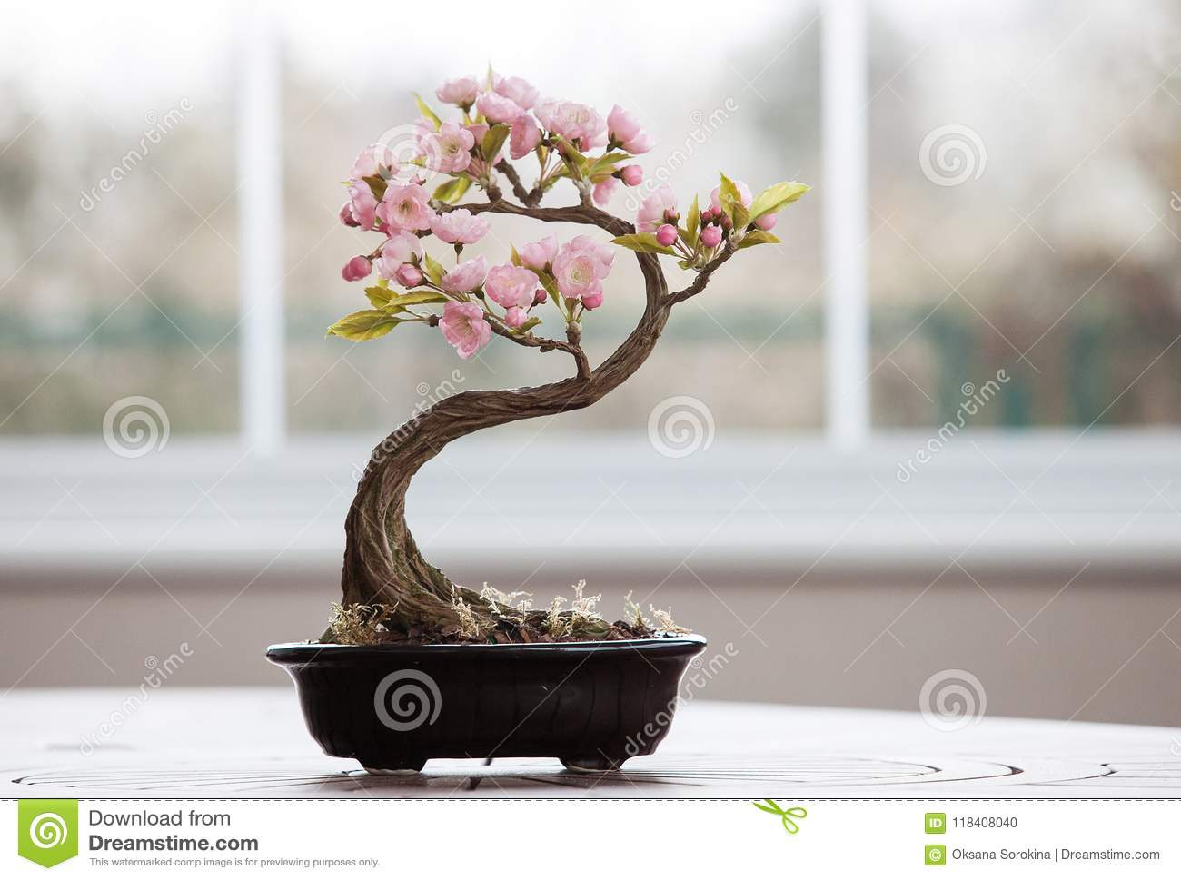 Artificial bonsai tree with flowers