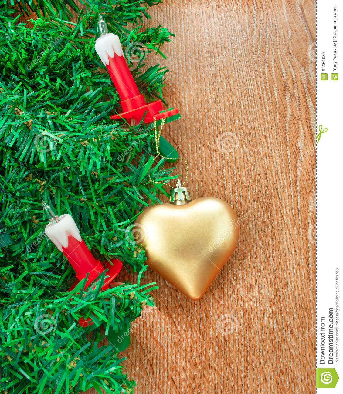 Artificial Christmas Tree, Electric Candles And Golden Heart Stock ...
