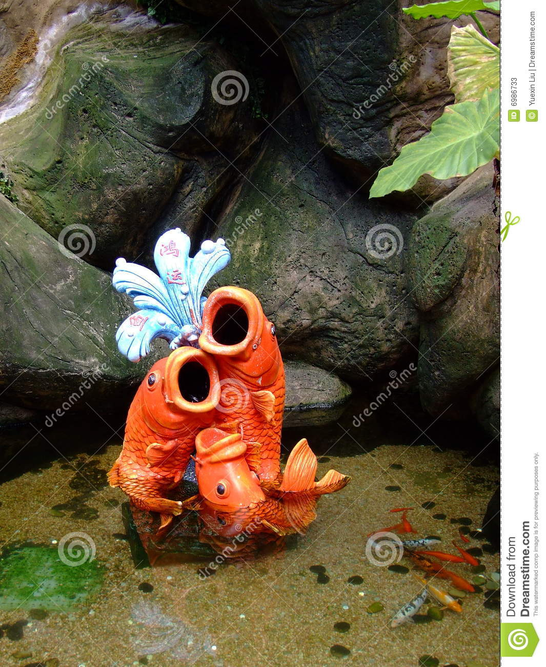 The artificial fish and the true fish stock photos image for Fake fish that swim