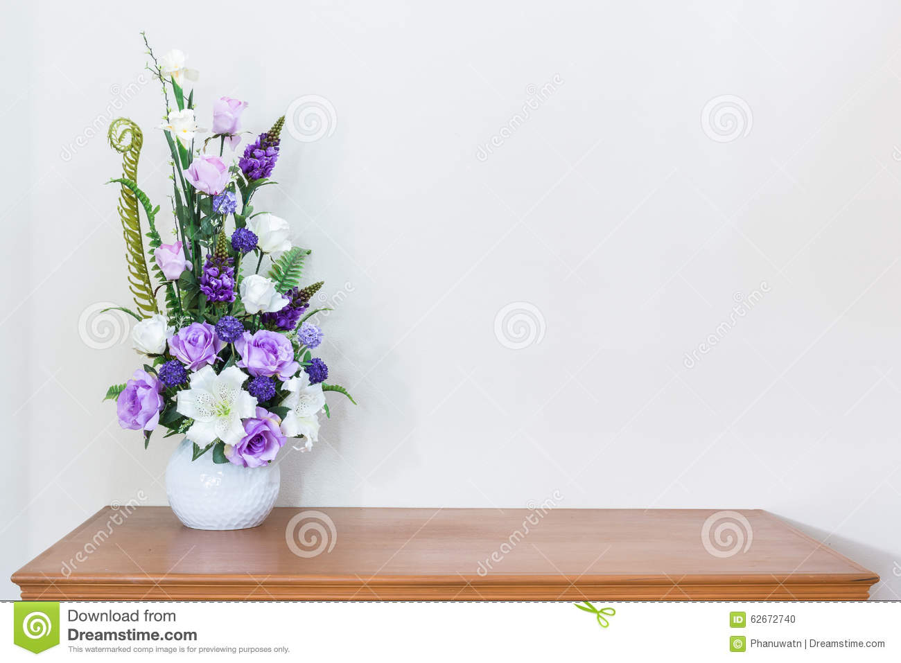 Picture of flower vase on the table roselawnlutheran artificial flower vase on wooden table and white wall reviewsmspy