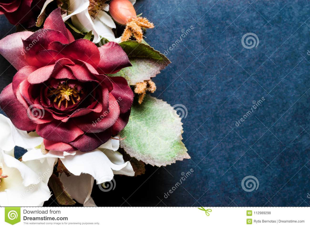 Artificial Flowers on Blue Background Surface and Vintage Style