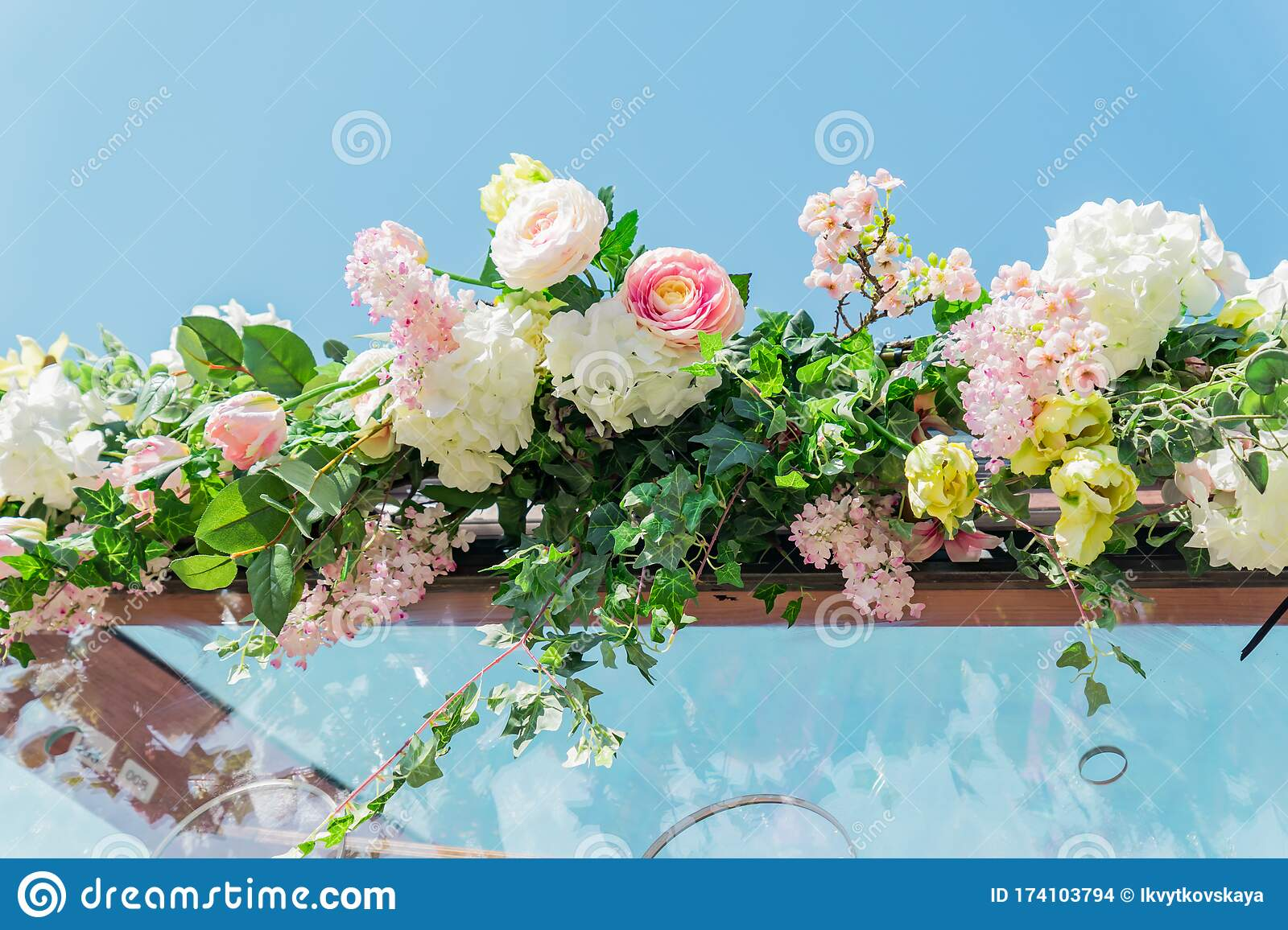 Artificial Flowers On Blue Sky Background Outdoors Street Decorations Close Up Stock Photo Image Of Artificial Detail 174103794