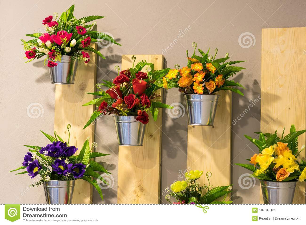 Artificial Flowers In Pots On The Wall. Stock Image - Image of ...